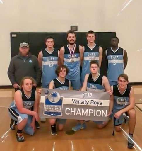High School Boys Basketball Wins State Title. Girls Finish Second.